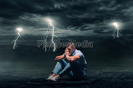 young man sitting on the ground