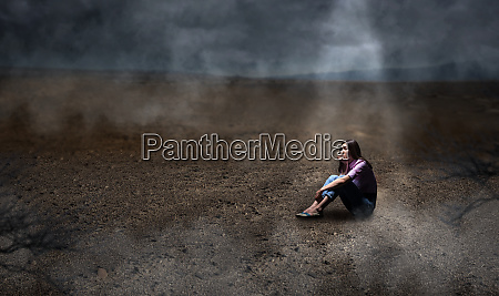 young woman sitting on the ground