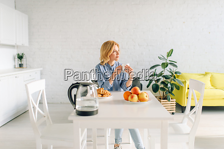 woman drinks coffee with milk on