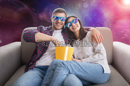 couple in 3d glasses sitting on