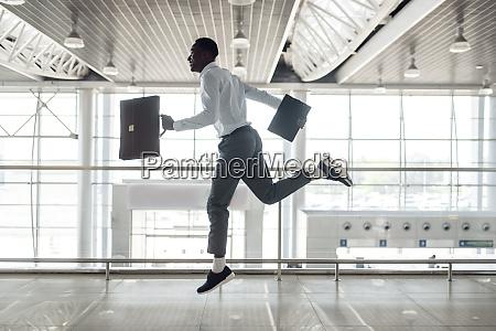 ebony businessman flies on the wings