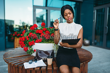 business woman resting on bench during