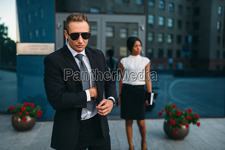 bodyguard in suit and sunglasses female