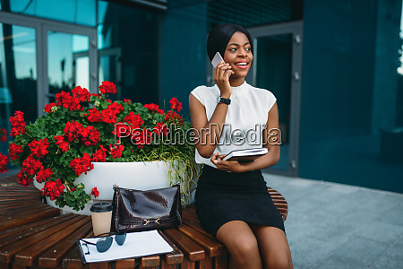 business lady talks by phone and