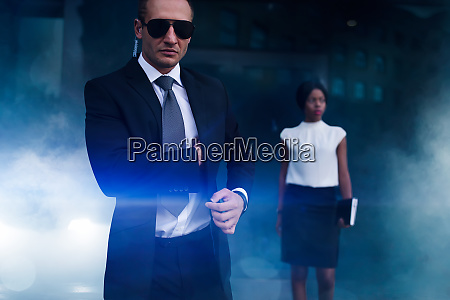serious bodyguard in suit sunglasses and