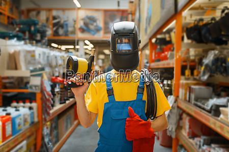 builder choosing welding equipment hardware store