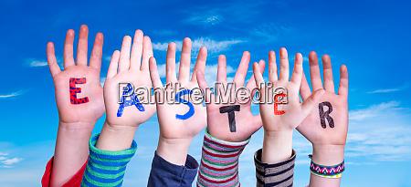children hands building word easter blue