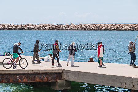 fishermen by the sea coming together