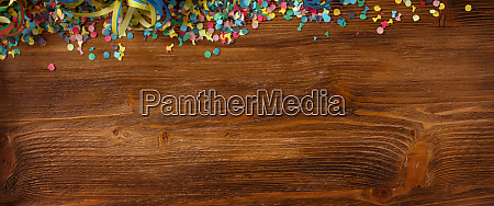 colorful confetti on wooden texture