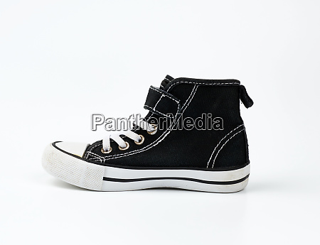 black textile sneaker with white tied