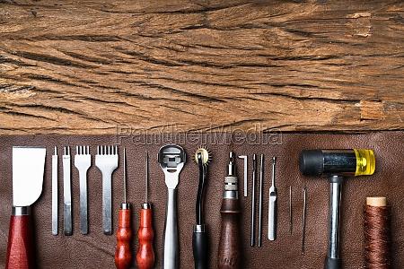 leather craft tools on desk