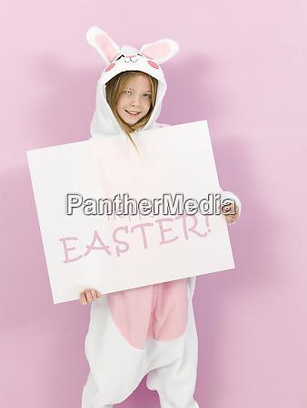pretty blonde girl with cozy rabbit