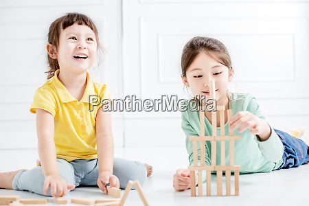 happy two little girls playing with