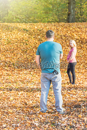 lifestyle portrait of expectant parents outdoors