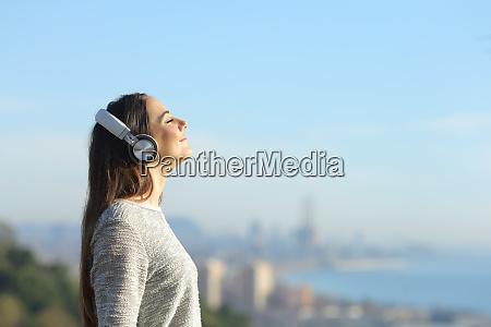 girl listening to music breathing standing