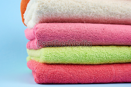 stack of colored cotton terry towels