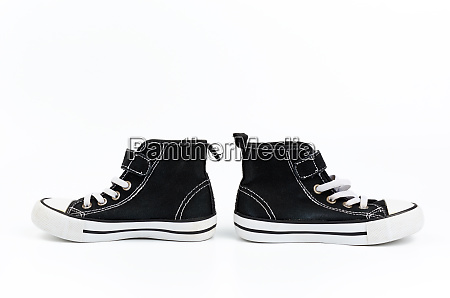 black textile sneakers with white tied