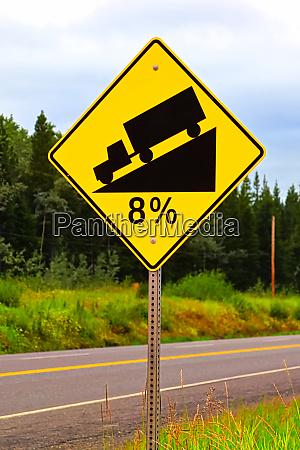an eight percent hill grade sign