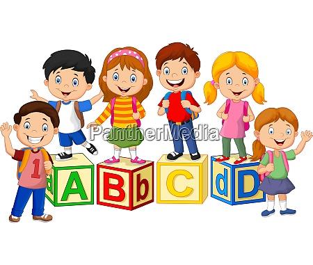 happy school children with alphabet blocks