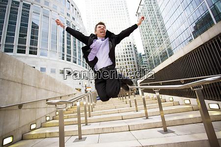 a businessman jumping for joy