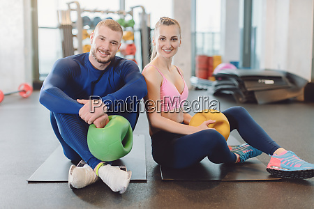 man and woman doing stomach or