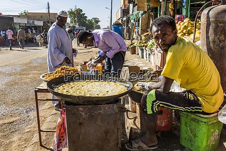 sudanese man frying falafel dongola northern