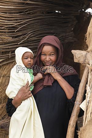 sudanese woman holding a baby kokka