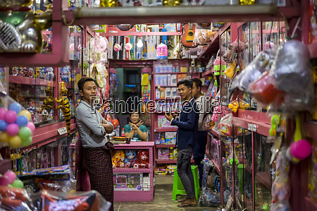 vendors and shoppers in a toy