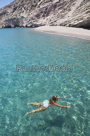 female tourist swimming in the clear