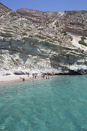 tourists swimming in the clear turquoise