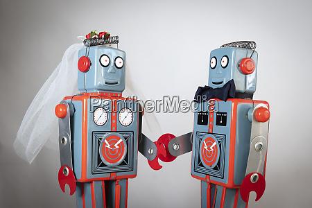 two heterosexual robots getting married