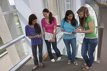 four teenage girls standing in a