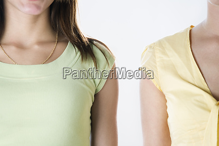 left shoulder of one woman and