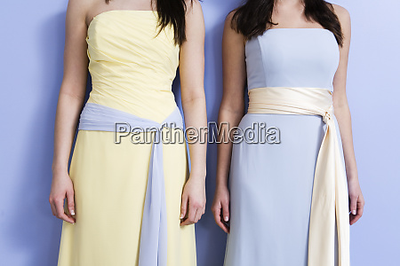 midsection of two bridesmaids standing
