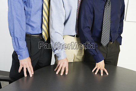 midsection of mid adult men standing