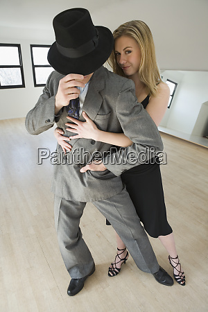 mid adult couple dancing argentine tango