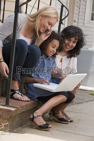 a young girl uses a laptop