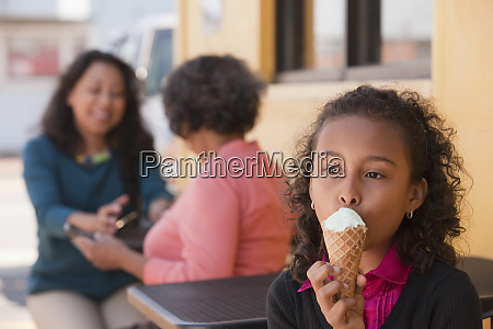 young girl enjoys an ice cream