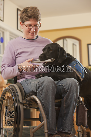 a service dog brings a remote