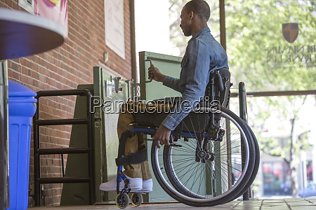 disabled man in a wheelchair open