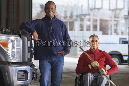 vehicle mechanic and man in wheelchair