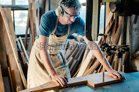 carpenter on the band saw in