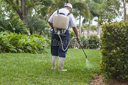 pest control technician with portable spray