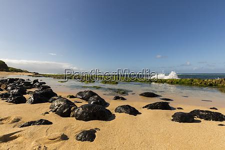 rocks on hookipa beach and a