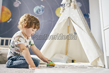 toddler playing in room childs teepee