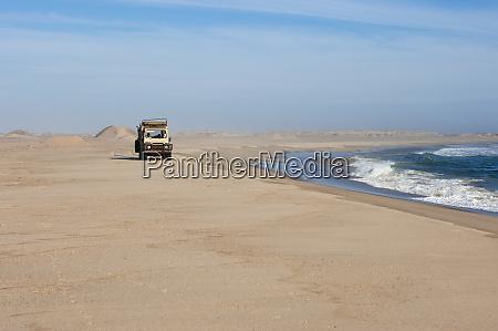 off road vehicle on sand dunes