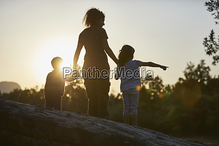 mother and children exploring nature at