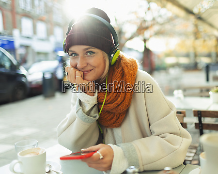 portrait confident young woman listening to