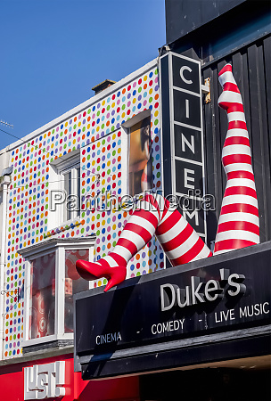 cinema sign and colourful retail facade