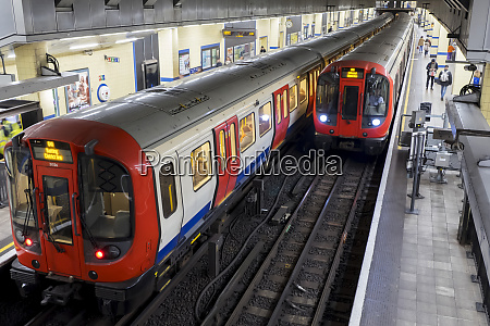 tube station with trains on the